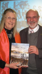 MLA Peter Crisp with Helen and her book