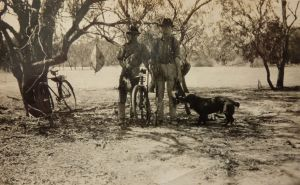 Bill Pearson (left) and Harold Pearson (right) duck hunting with their dog at Lock 4
