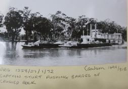 Captain sturt pushing barges crushed stone